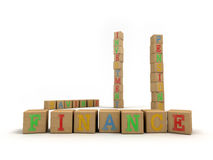 Finance concept - Child's play building blocks. A concept for easy financial services using a child's wooden alphabet building blocks. Emphasis on the word Royalty Free Stock Images