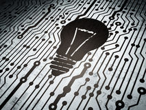 Finance concept: circuit board with Light Bulb Stock Image