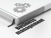 Finance concept: book Gears, Business Management on white background. Finance concept: closed book with Black Gears icon and text Business Management on floor Stock Photo