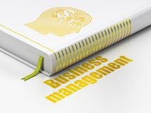 Finance concept: book Head With Finance Symbol, Business Management on white background. Finance concept: closed book with Gold Head With Finance Symbol icon and Royalty Free Stock Photography