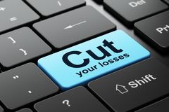 Finance concept: Cut Your losses on computer keyboard background. Finance concept: computer keyboard with word Cut Your losses, selected focus on enter button Royalty Free Stock Images