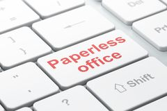 Finance concept: Paperless Office on computer keyboard background. Finance concept: computer keyboard with word Paperless Office, selected focus on enter button Royalty Free Stock Photos
