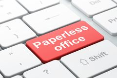 Finance concept: Paperless Office on computer keyboard background. Finance concept: computer keyboard with word Paperless Office, selected focus on enter button Stock Image