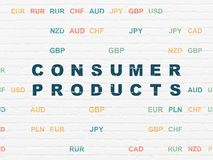 Finance concept: Consumer Products on wall background. Finance concept: Painted blue text Consumer Products on White Brick wall background with Currency Royalty Free Stock Photo