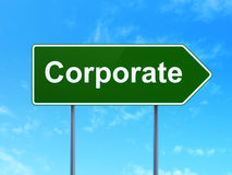 Finance concept: Corporate on road sign background Stock Photo