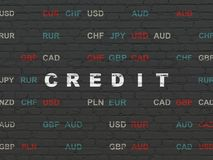 Finance concept: Credit on wall background. Finance concept: Painted white text Credit on Black Brick wall background with Currency Royalty Free Stock Images