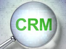 Finance concept: CRM with optical glass. Finance concept: magnifying optical glass with words CRM on digital background, 3D rendering Stock Photo