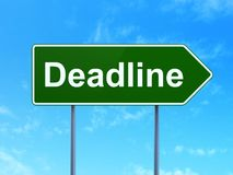 Finance concept: Deadline on road sign background. Finance concept: Deadline on green road highway sign, clear blue sky background, 3D rendering Royalty Free Stock Image