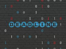 Finance concept: Deadline on wall background. Finance concept: Painted blue text Deadline on Black Brick wall background with Binary Code Royalty Free Stock Photography
