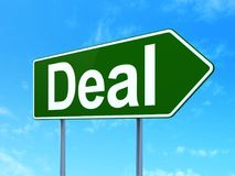 Finance concept: Deal on road sign background. Finance concept: Deal on green road highway sign, clear blue sky background, 3D rendering Stock Photos