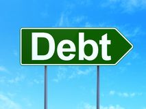 Finance concept: Debt on road sign background. Finance concept: Debt on green road highway sign, clear blue sky background, 3D rendering Royalty Free Stock Image