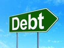 Finance concept: Debt on road sign background. Finance concept: Debt on green road highway sign, clear blue sky background, 3D rendering Royalty Free Stock Photos