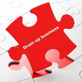 Finance concept: Drum up business on puzzle background. Finance concept: Drum up business on Red puzzle pieces background, 3D rendering Stock Photo