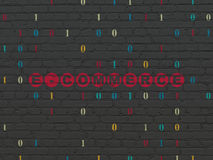 Finance concept: E-commerce on wall background. Finance concept: Painted red text E-commerce on Black Brick wall background with Binary Code, 3d render Royalty Free Stock Images