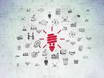 Finance concept: Energy Saving Lamp on Digital Data Paper background. Finance concept: Painted red Energy Saving Lamp icon on Digital Data Paper background with Stock Image