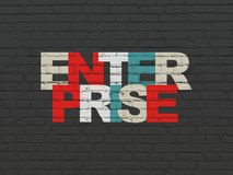 Finance concept: Enterprise on wall background. Finance concept: Painted multicolor text Enterprise on Black Brick wall background Stock Photo