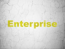Finance concept: Enterprise on wall background. Finance concept: Yellow Enterprise on textured concrete wall background Stock Photography