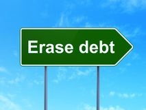 Finance concept: Erase Debt on road sign background. Finance concept: Erase Debt on green road highway sign, clear blue sky background, 3D rendering Stock Image