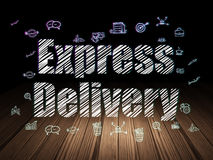 Finance concept: Express Delivery in grunge dark. Finance concept: Glowing text Express Delivery,  Hand Drawn Business Icons in grunge dark room with Wooden Royalty Free Stock Photography