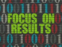Finance concept: Focus on RESULTS on wall background. Finance concept: Painted green text Focus on RESULTS on Black Brick wall background with Binary Code Royalty Free Stock Photography