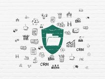 Finance concept: Folder With Shield on wall background. Finance concept: Painted green Folder With Shield icon on White Brick wall background with  Hand Drawn Royalty Free Stock Photo