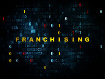 Finance concept: Franchising on Digital background. Finance concept: Pixelated yellow text Franchising on Digital wall background with Binary Code, 3d render Stock Photo