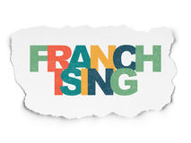 Finance concept: Franchising on Torn Paper. Finance concept: Painted multicolor text Franchising on Torn Paper background with  , 3d render Royalty Free Stock Image