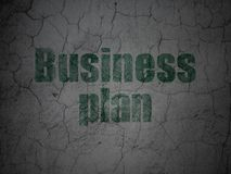 Finance concept: Business Plan on grunge wall background. Finance concept: Green Business Plan on grunge textured concrete wall background Stock Photo