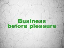 Finance concept: Business Before pleasure on wall background. Finance concept: Green Business Before pleasure on textured concrete wall background Royalty Free Stock Photography
