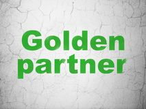 Finance concept: Golden Partner on wall background. Finance concept: Green Golden Partner on textured concrete wall background Stock Photos