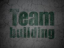 Finance concept: Team Building on grunge wall background. Finance concept: Green Team Building on grunge textured concrete wall background Stock Images