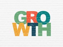 Finance concept: Growth on wall background. Finance concept: Painted multicolor text Growth on White Brick wall background Royalty Free Stock Photography