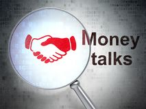 Finance concept: Handshake and Money Talks with optical glass. Finance concept: magnifying optical glass with Handshake icon and Money Talks word on digital Royalty Free Stock Images