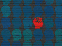 Finance concept: head with finance symbol icon on. Finance concept: rows of Painted blue head icons around red head with finance symbol icon on Black Brick wall Stock Image