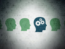 Finance concept: head with gears icon on Digital. Finance concept: row of Painted green head icons around blue head with gears icon on Digital Paper background Stock Images