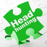 Finance concept: Head Hunting on puzzle background Stock Image