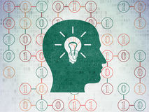 Finance concept: Head With Light Bulb on Digital Paper background Royalty Free Stock Images