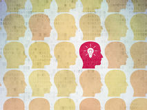 Finance concept: head with light bulb icon on. Finance concept: rows of Painted yellow head icons around red head with light bulb icon on Digital Paper Stock Images