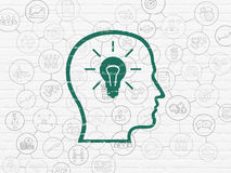 Finance concept: Head With Lightbulb on wall. Finance concept: Painted green Head With Lightbulb icon on White Brick wall background with Scheme Of Hand Drawn Royalty Free Stock Image