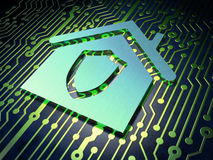 Finance concept: Home on circuit board background Royalty Free Stock Photography