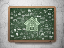 Finance concept: Home on School Board background Stock Image