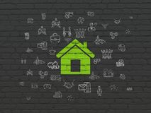 Finance concept: Home on wall background. Finance concept: Painted green Home icon on Black Brick wall background with  Hand Drawn Business Icons Stock Images