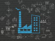 Finance concept: Industry Building on wall background. Finance concept: Painted blue Industry Building icon on Black Brick wall background with Scheme Of Hand Royalty Free Stock Image
