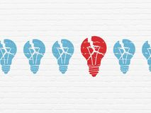 Finance concept: light bulb icon on wall background. Finance concept: row of Painted blue light bulb icons around red light bulb icon on White Brick wall Stock Photos
