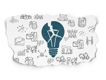 Finance concept: Light Bulb on Torn Paper background. Finance concept: Painted blue Light Bulb icon on Torn Paper background with  Hand Drawn Business Icons Stock Photos