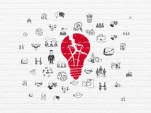 Finance concept: Light Bulb on wall background. Finance concept: Painted red Light Bulb icon on White Brick wall background with  Hand Drawn Business Icons Royalty Free Stock Image