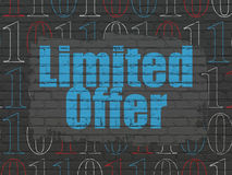 Finance concept: Limited Offer on wall background. Finance concept: Painted blue text Limited Offer on Black Brick wall background with  Binary Code, 3d render Royalty Free Stock Photography