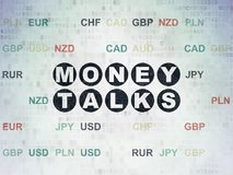 Finance concept: Money Talks on Digital Data Paper background. Finance concept: Painted black text Money Talks on Digital Data Paper background with Currency Royalty Free Stock Image