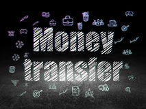 Finance concept: Money Transfer in grunge dark. Finance concept: Glowing text Money Transfer,  Hand Drawn Business Icons in grunge dark room with Dirty Floor Royalty Free Stock Photo