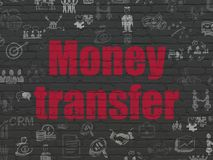 Finance concept: Money Transfer on wall background. Finance concept: Painted red text Money Transfer on Black Brick wall background with  Hand Drawn Business Royalty Free Stock Photo